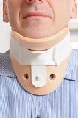 stock photo of neck brace  - Man with a surgical cervical collar suffering from neck pain - JPG