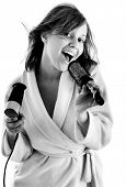 image of housecoat  - Woman singing with hairbrush in black and white - JPG