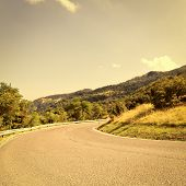picture of italian alps  - Winding Paved Road in the Italian Alps Vintage Style Toned Picture - JPG