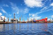 image of big-rig  - Ships on dock and oil rig in shipyard of Gdansk Poland - JPG