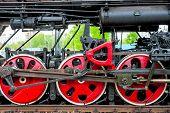 picture of locomotive  - wheel steam locomotive close up on the rails - JPG