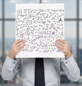 image of mathematics  - businessman holding poster with mathematics equations and formulas - JPG