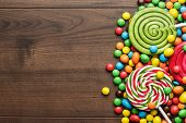picture of lollipop  - different colorful sweets and lollipops on the wooden table - JPG
