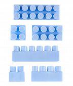 stock photo of foreshortening  - Set of blue plastic toy construction block bricks isolated over the white background - JPG