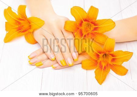 french manicure with orange lily. spa