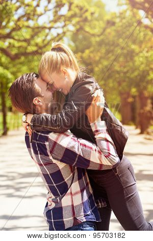 Loving Couple Having Fun In The Park