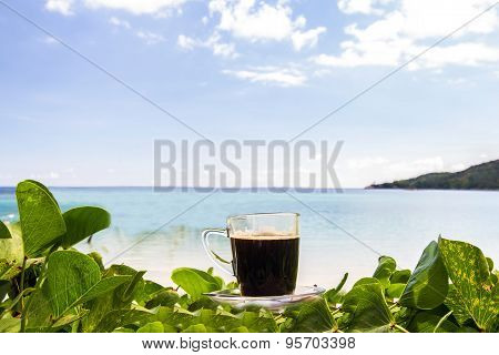 Black Coffee With Views On The Beach And Blue Sky