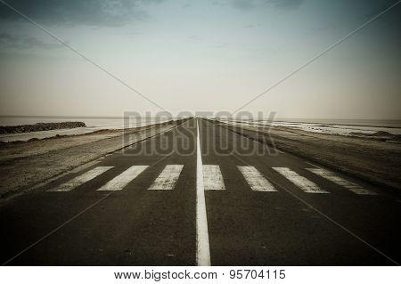 Empty Dark Road Near The Chott El Jerid