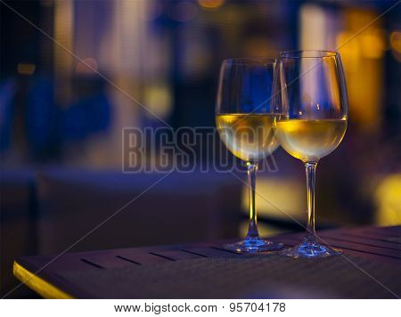 Two Glasses Of The White Wine In The Night