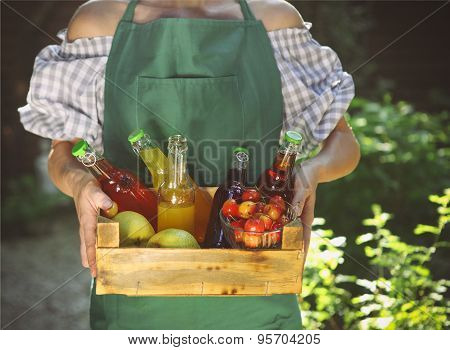 Woman Holding Wooden Box With Bottles Of Lemonade