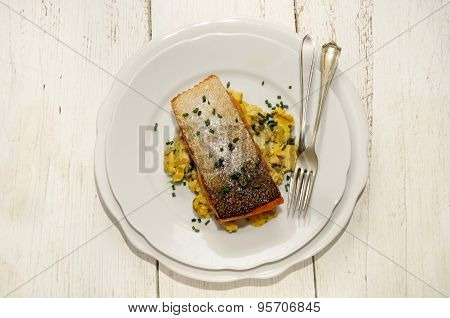 Grilled Salmon Fillet On Scrambled Eggs