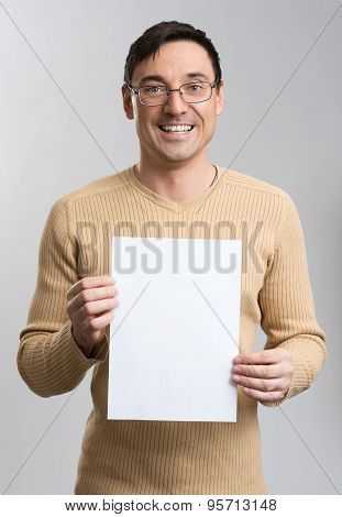 Young Man Holding A Blank Sheet