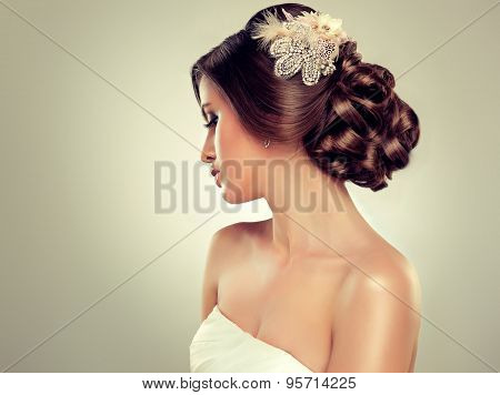 Girl bride woman  in wedding dress with elegant hairstyle