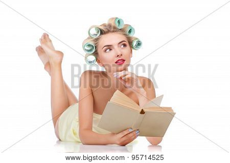 Attractive young housewife is reading something interesting
