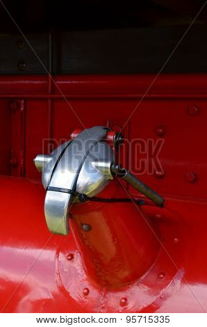 Metal fuel filler cap on vehicle.