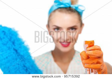 Attractive young girl is cleaning her house