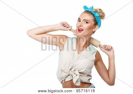 Cheerful young woman is making fun before baking