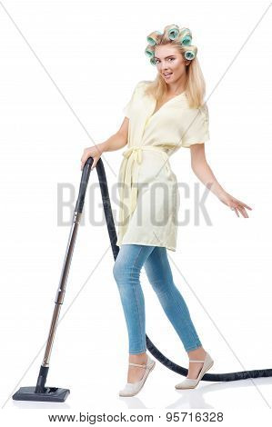 Attractive young woman is cleaning her house