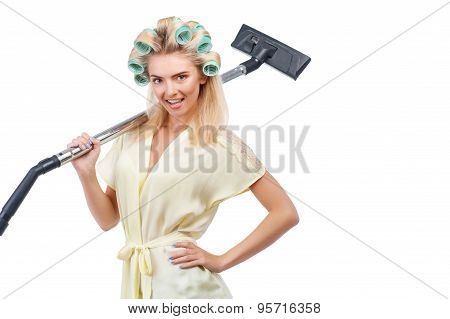 Cheerful young blond housewife is doing cleanup