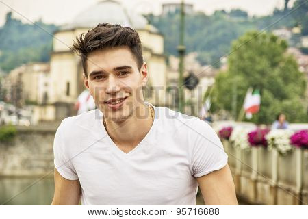 Handsome young man in white t-shirt outdoor in city
