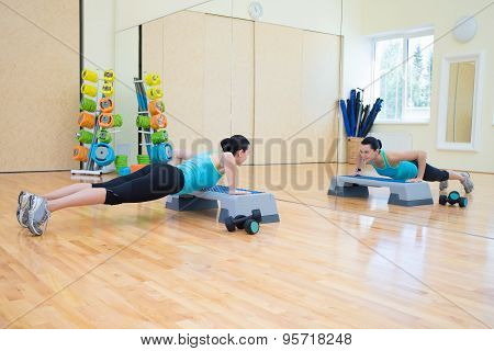 Beautiful Slim Woman Doing Push Ups With Stepper In Gym
