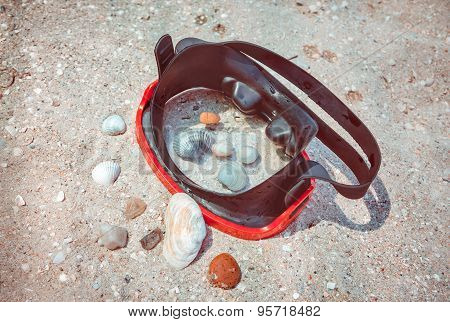 diving mask on the beach sand