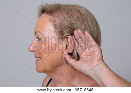 Elderly Lady With Hearing Problems