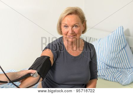 Male Nurse Or Doctor Taking A Blood Pressure