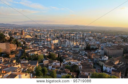 Panoramic view of city of Granada and its outskirts with distant mountains