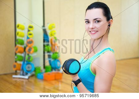 Beautiful Sporty Woman Working Out And Listening Music In Gym