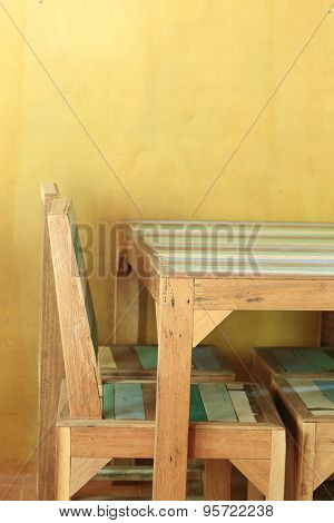 Table Wood In Yellow Room With Mortar Wall