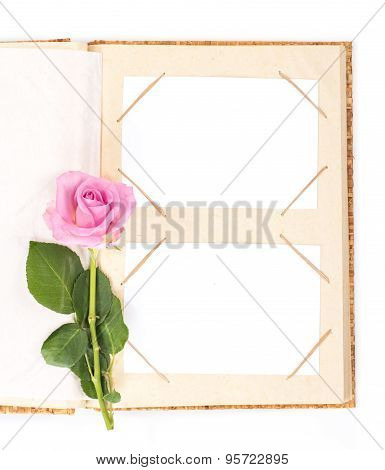 open photo album book with two place and rose.