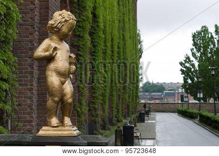 Golden girl sculpture