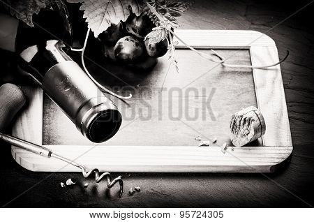 Frame With Wine Bottle And Fresh Grape