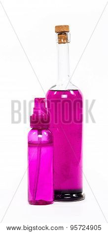 isolated spray and bottle of rose oil