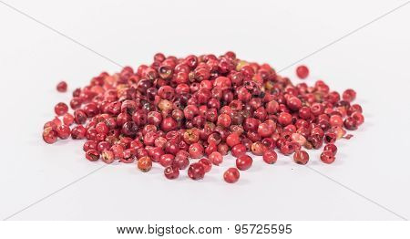 pile of red peppercorn isolated on white