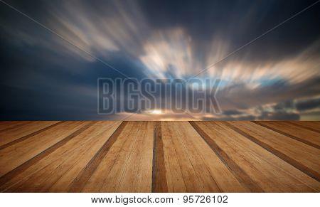 Beautiful Sunset Long Exposure Image Over Ocean With Wooden Planks Floor