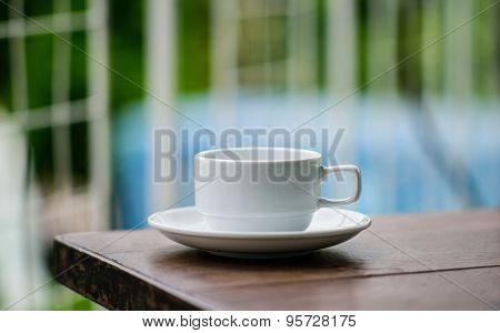 cup of coffee on table outdoor in cafe shop