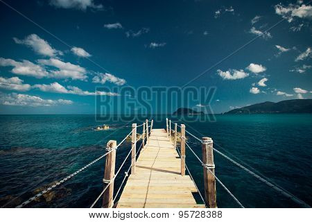 travel and vacation concept - wooden bridge, sea, summer, vacation, happy time