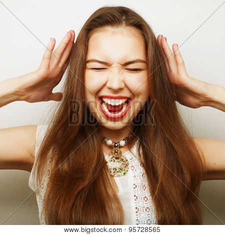 young  woman with a headache holding head