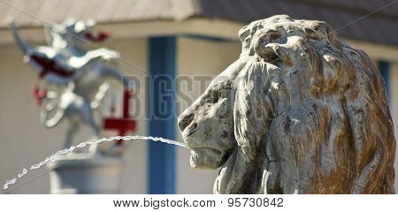 A Lion Statue Shoots An Arc Of Water