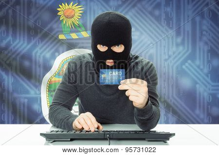Hacker Holding Credit Card And Usa State Flag On Background - Kansas