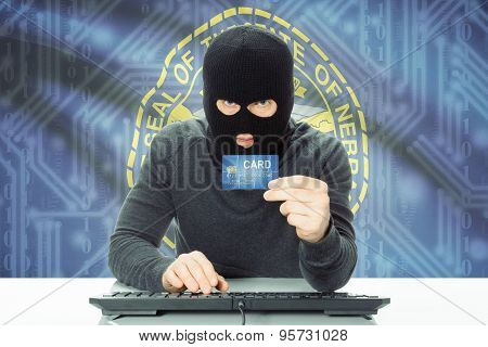 Hacker Holding Credit Card And Usa State Flag On Background - Nebraska