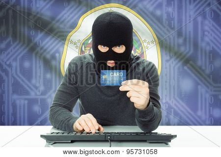 Hacker Holding Credit Card And Usa State Flag On Background - Minnesota