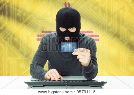 Hacker Holding Credit Card And Usa State Flag On Background - New Mexico