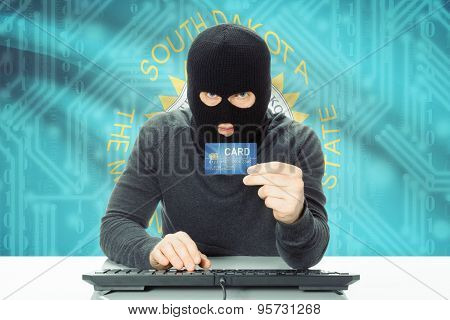 Hacker Holding Credit Card And Usa State Flag On Background - South Dakota