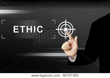 Business Hand Pushing Ethic Button On Touch Screen