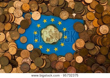 burnt European flag euro coins background