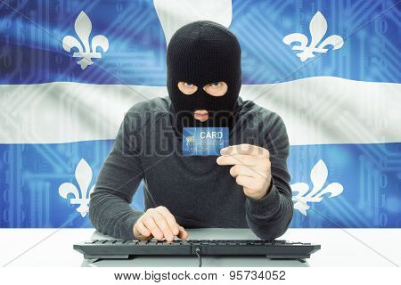 Hacker Holding Credit Card And Canadian Province Flag On Background - Quebec