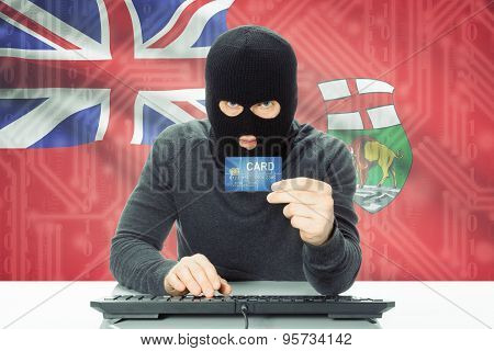 Hacker Holding Credit Card And Canadian Province Flag On Background - Manitoba
